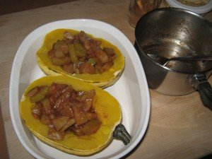 Squash halves, filled with sautéed pears, ready for final 5 minutes in microwave