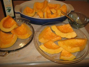 Sliced up pumpkin, lightly basted with olive oil, ready for oven roasting