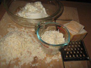 Ricotta, half the Parmigiano-Reggiano and an egg to be whisked in bowl