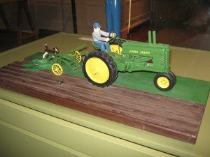 Kelley, who never learned to drive a car or had a license, loved the John Deere tractor; Note the carved dog & bird in this farming vignette
