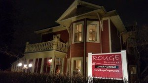 Rouge, farm to table dining in Calgary, located in an 1891 house that has been forever painted red