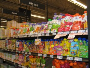 "Aisle at the Honest Weight Food Co-op for baby food: Co-op's food policy considers ""moral & ethical production, environmental stewardship, healthy living a & safety"