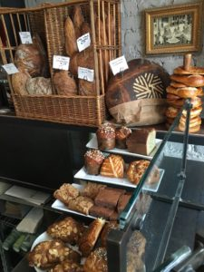 Breads and pastries for the day including Bolzano niche (made with rye, spelt, cumin, coriander & fennel) and the bakery's millstone logo in its crust