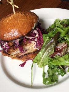 Fried chicken sandwich on brioche with cabbage slaw & garlic mayo