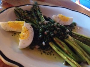 Appetizing oven-roasted asparagus with lovage salsa verde and egg