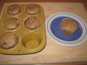 Flavorful & tangy cranberry pecan muffins out of the oven